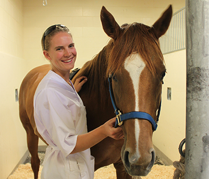 Jessica Semper with one of the horses involved in the firocoxib study. Submitted photo.